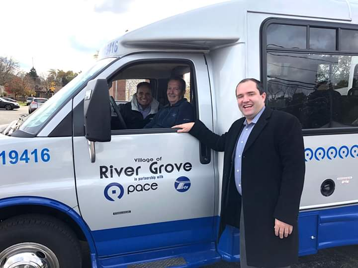 Mayor Dave Guerin standing next to our new Pace Bus