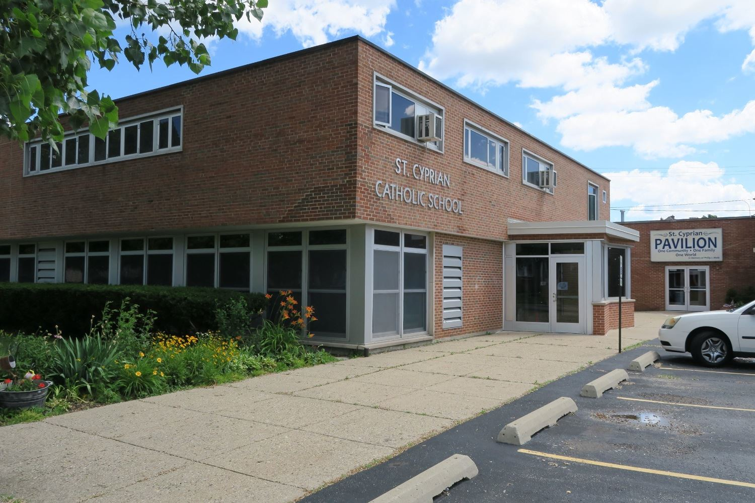 Exterior view of St. Cyprian school 's brick facade and south entrance